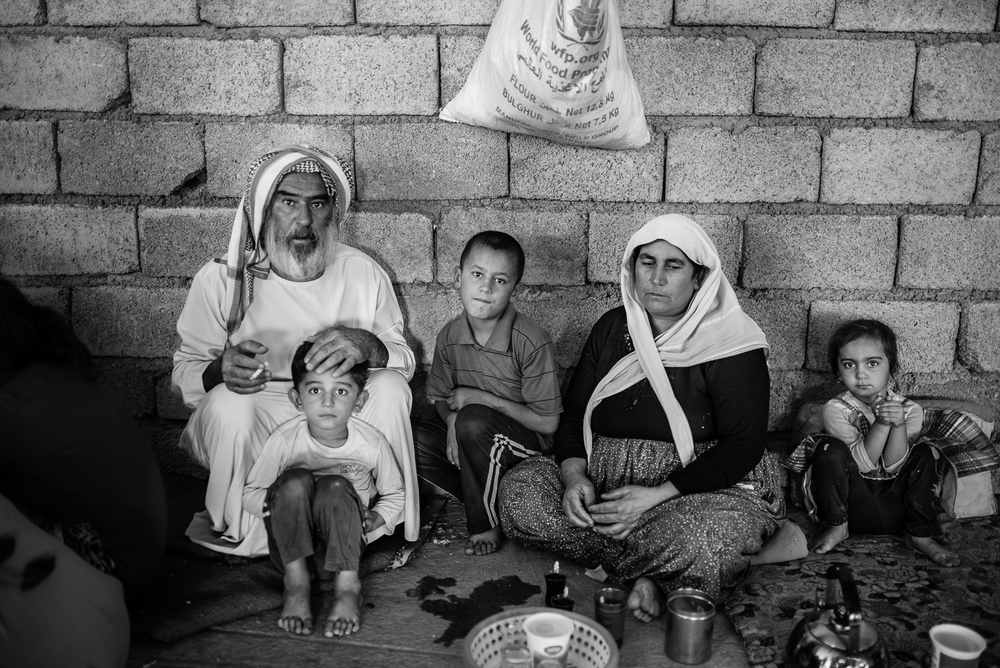 Family, building under construction in Zakho