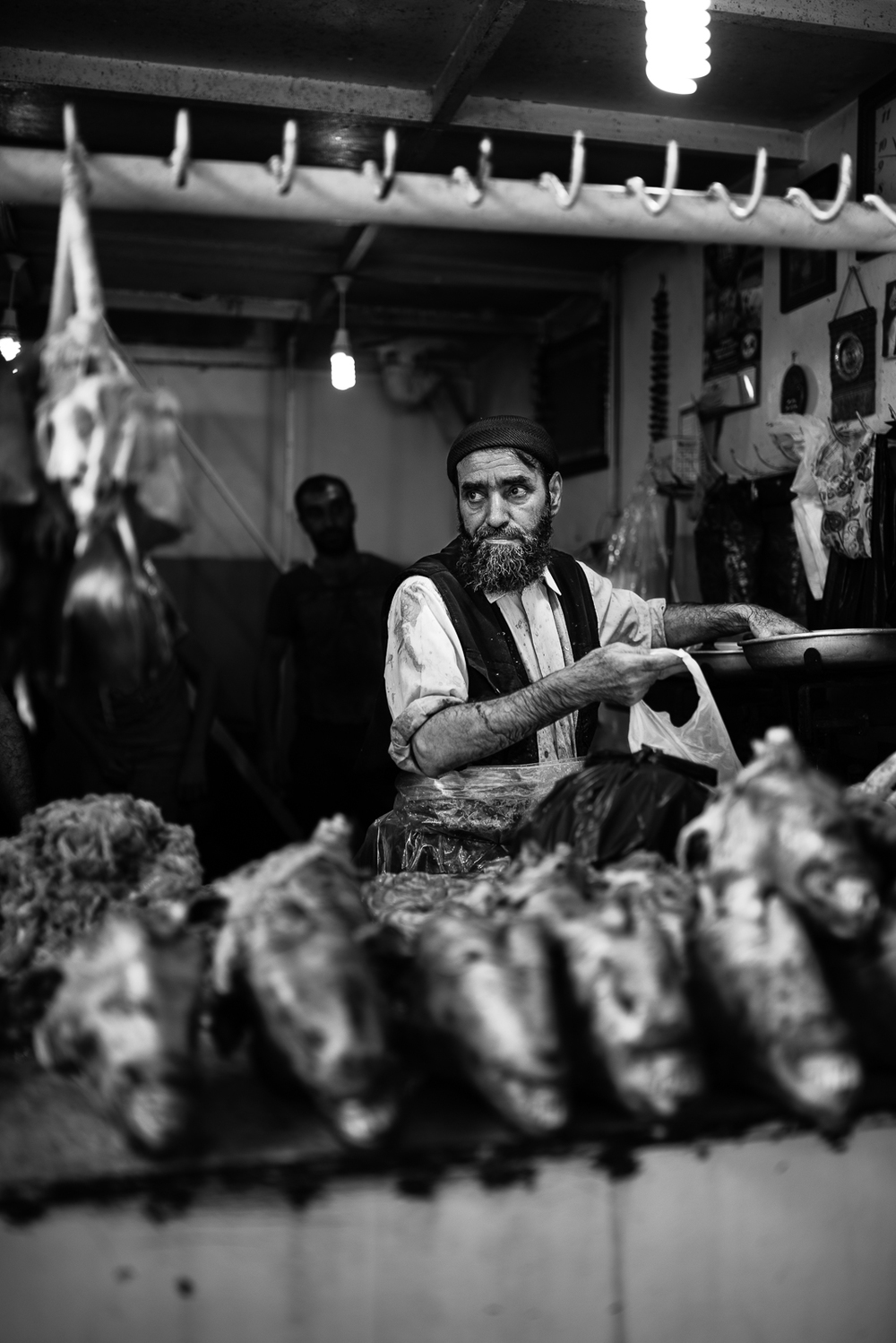 A butcher inside the Diyarbakir's meat bazar. The video of this photo is  here