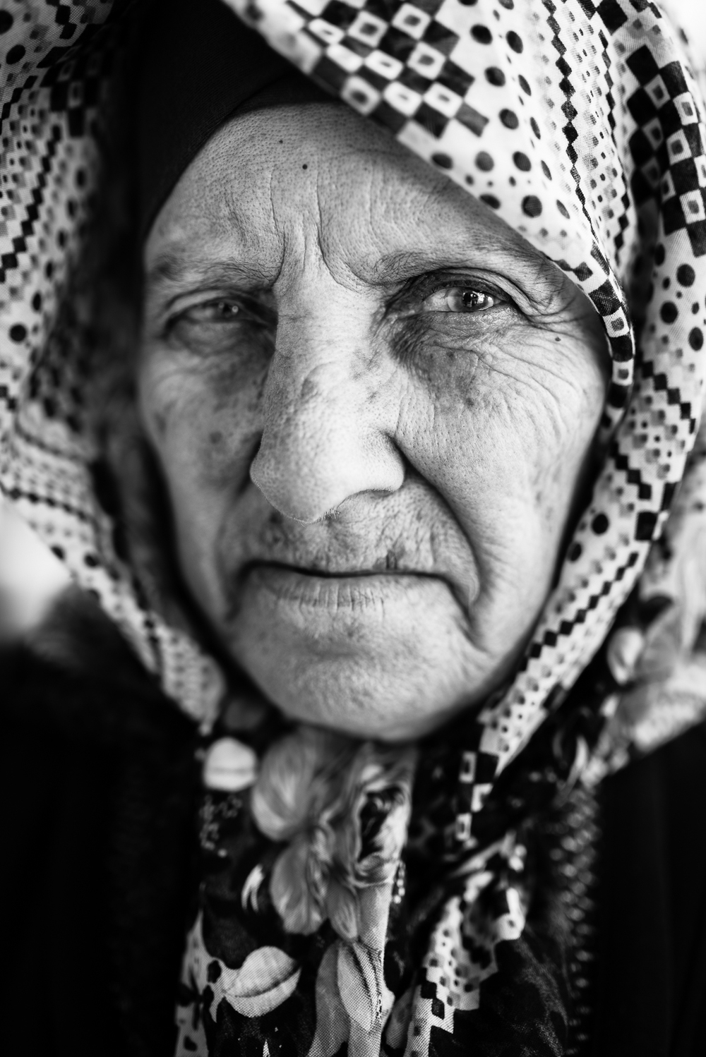 A suspectus gaze of an elder lady in Gaziantep. The video of this photo is  here