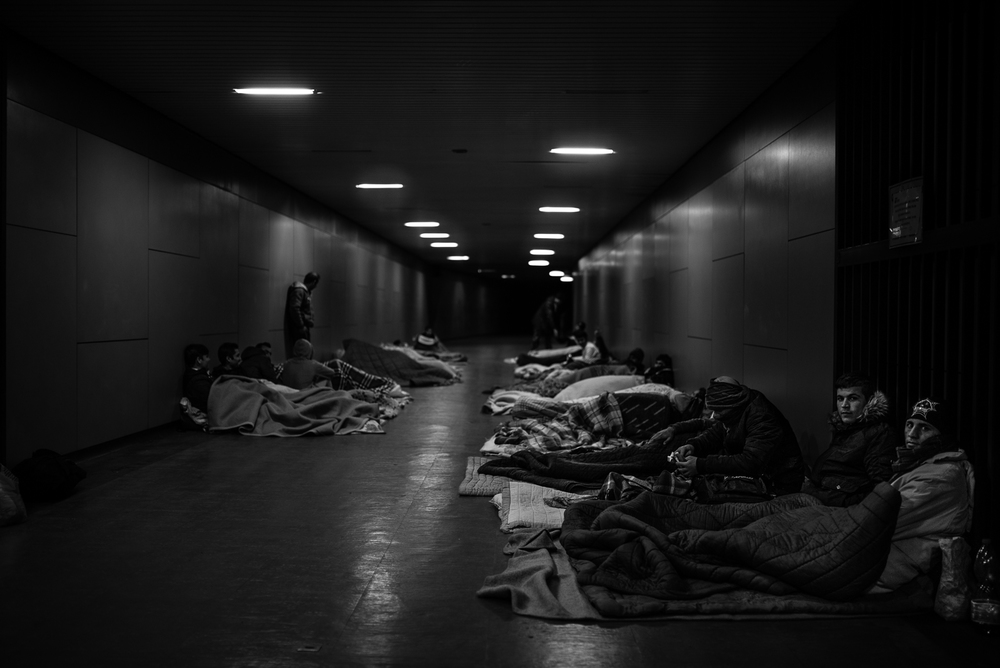 Migrants are sleeping in a tunnel of the railway station