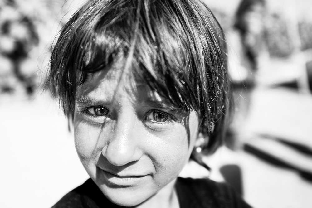 A little yazidi girl in a temporary refugees camp in the desert, somewhere between Zakho and Sinjar. Iraq