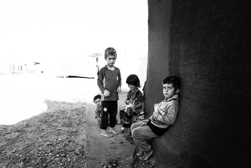 Children are playing inside the Essian refugees camp, one of the biggest refugees camp in Iraq.