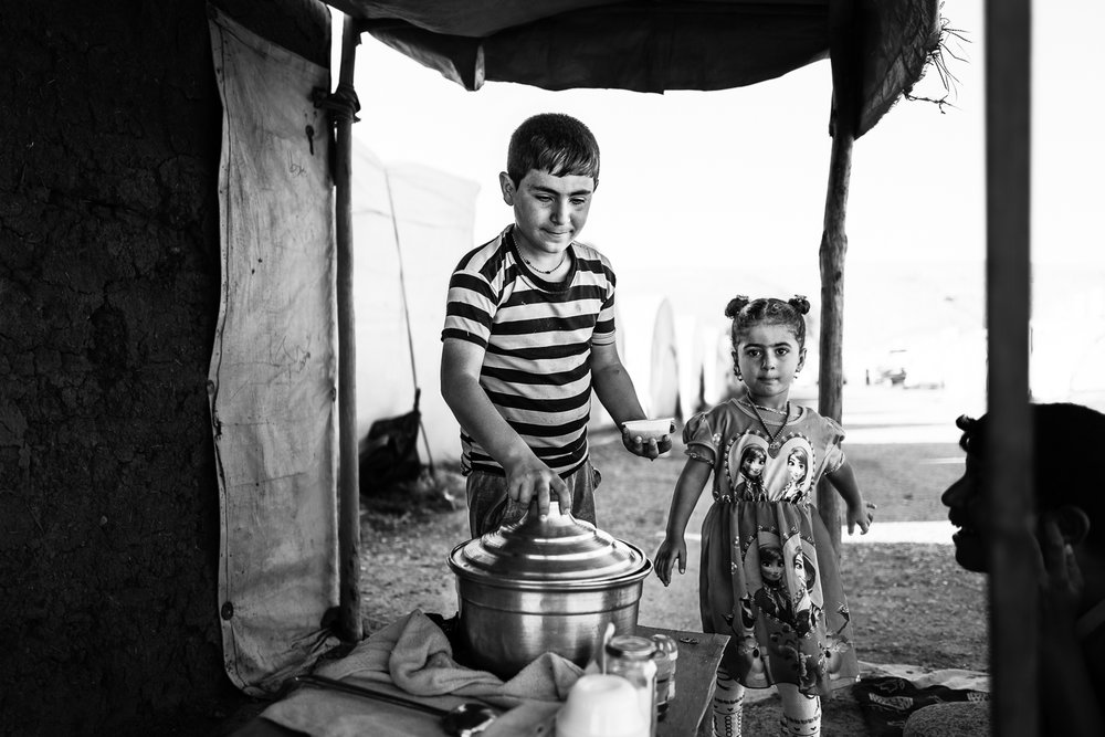 Lunch inside the Essian refugees camp, one of the biggest refugees camp in Iraq