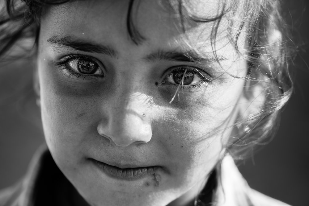Yazidi girl inside the Essian refugees camp, one of the biggest refugees camp in Iraq