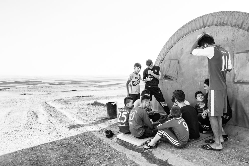 Boys spend time in Essian refugees camp, one of the biggest refugees camp in Iraq.