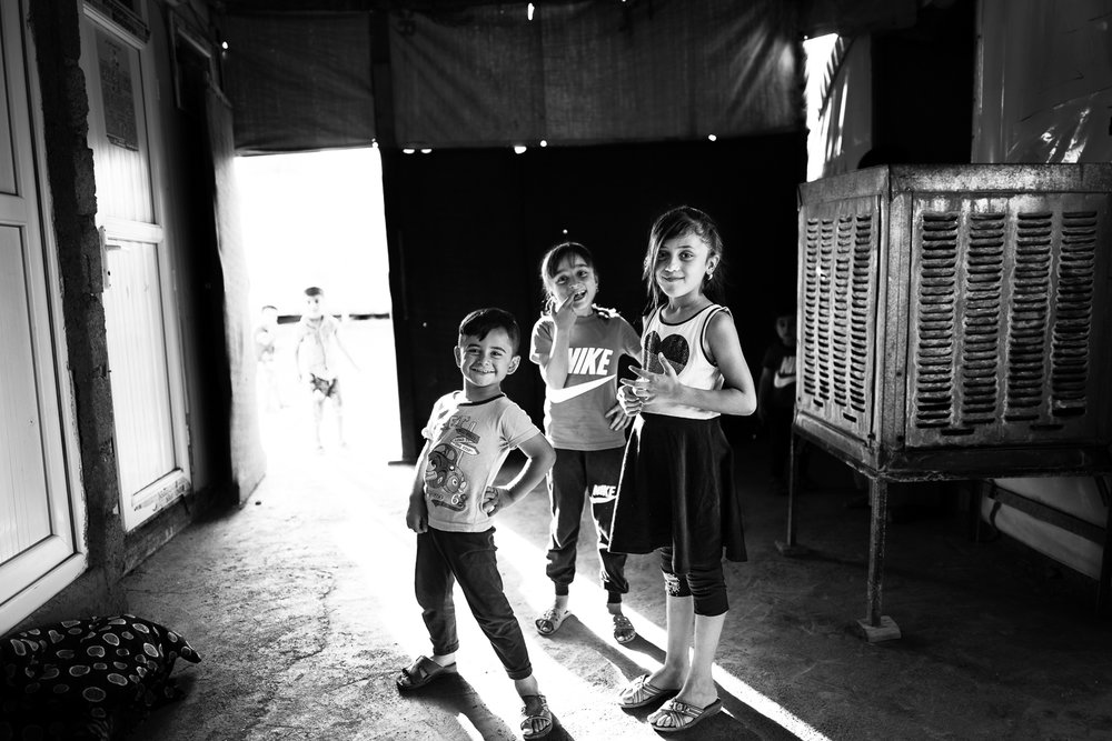 Children are playing inside their house in Essian refugees camp, one of the biggest refugees camp in Iraq.