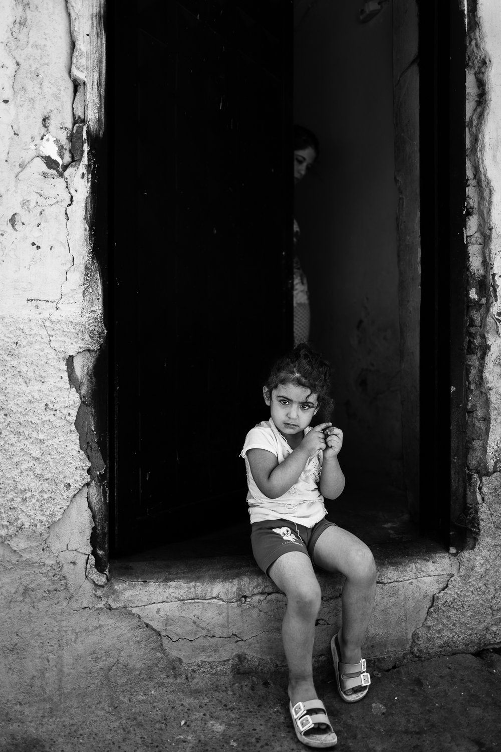 Kurdish girl on her home's door in Diyarbakir (Turkey)