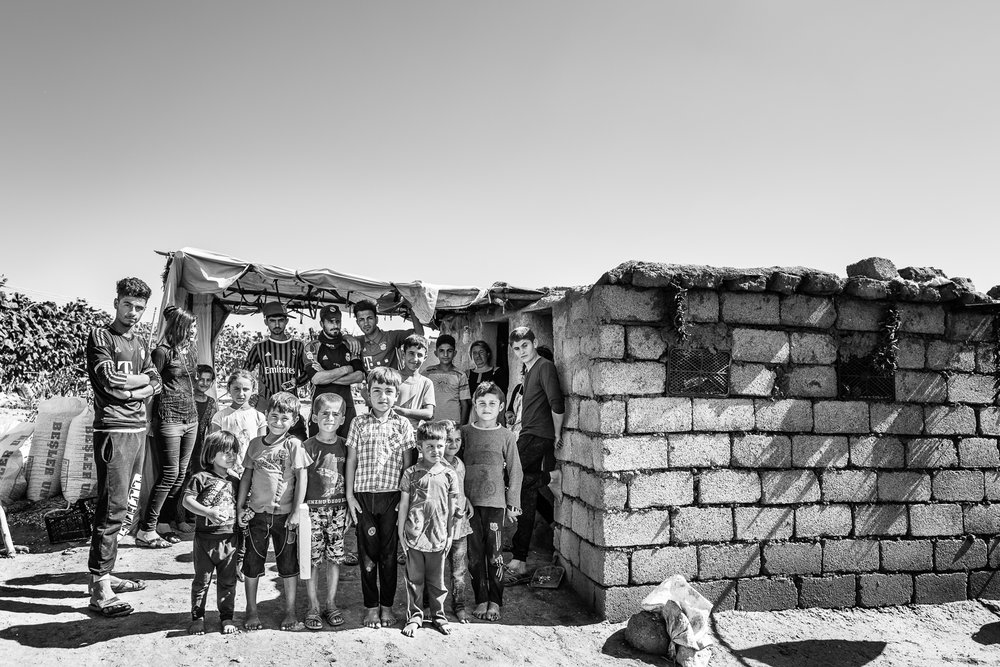 Boys and children of a Yazidi temporary refugees camp in the desert, somewhere between Zakho and Sinjar. Iraq