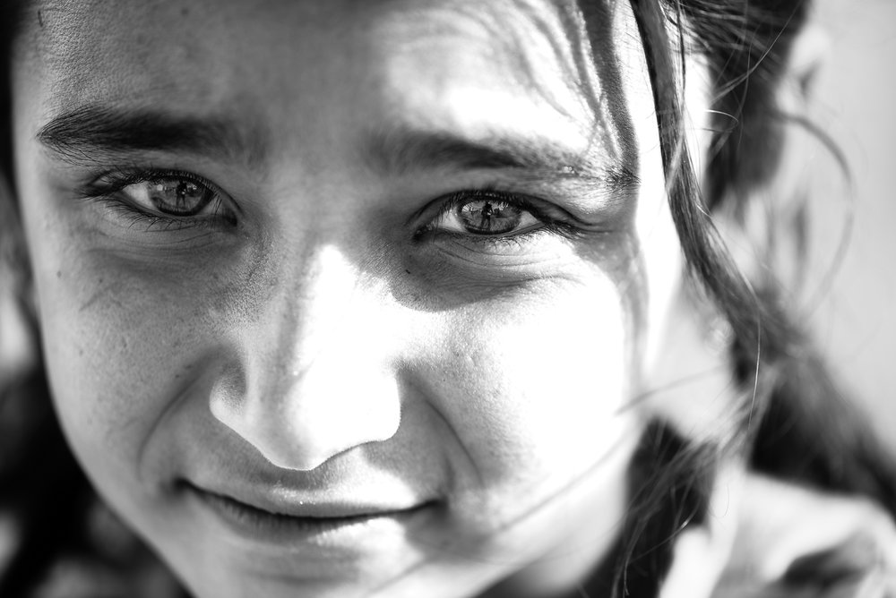 A little Yazidi girl under the sun in  Essian refugees camp, one of the biggest refugees camp in Iraq