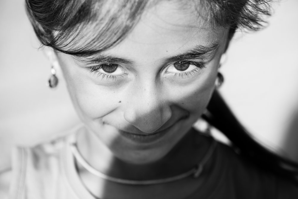 The gaze of a little yazidi girl inside the Essian refugees, Iraq.