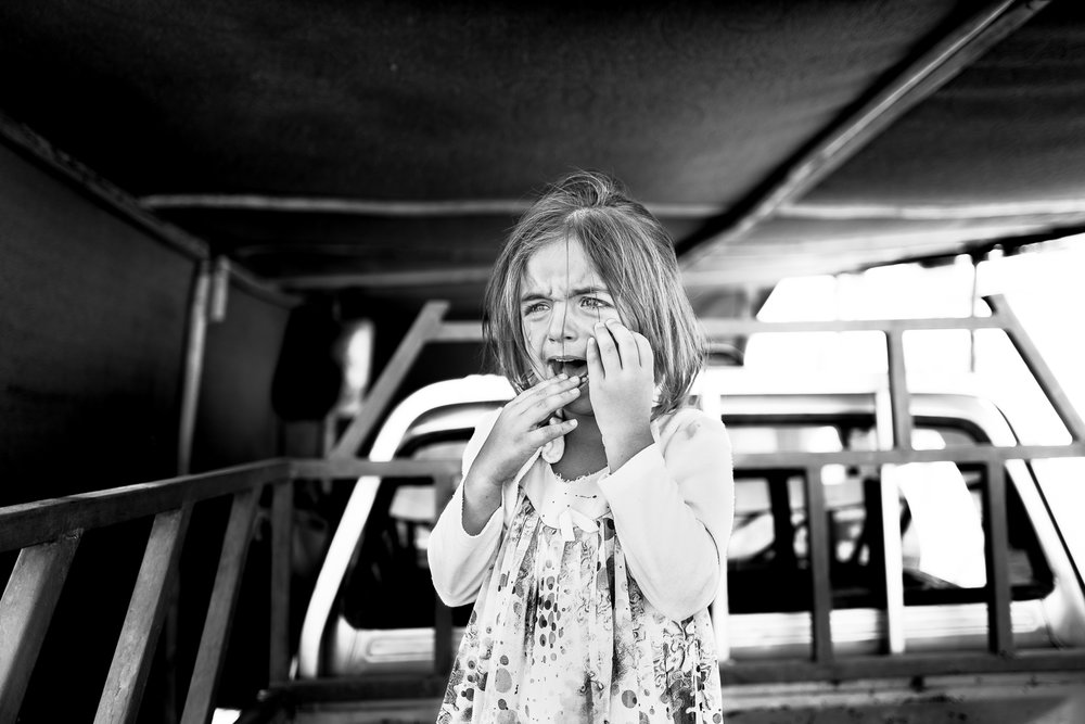 A little yazidi girl is crying inside the Essend refugess camp in north Iraq.