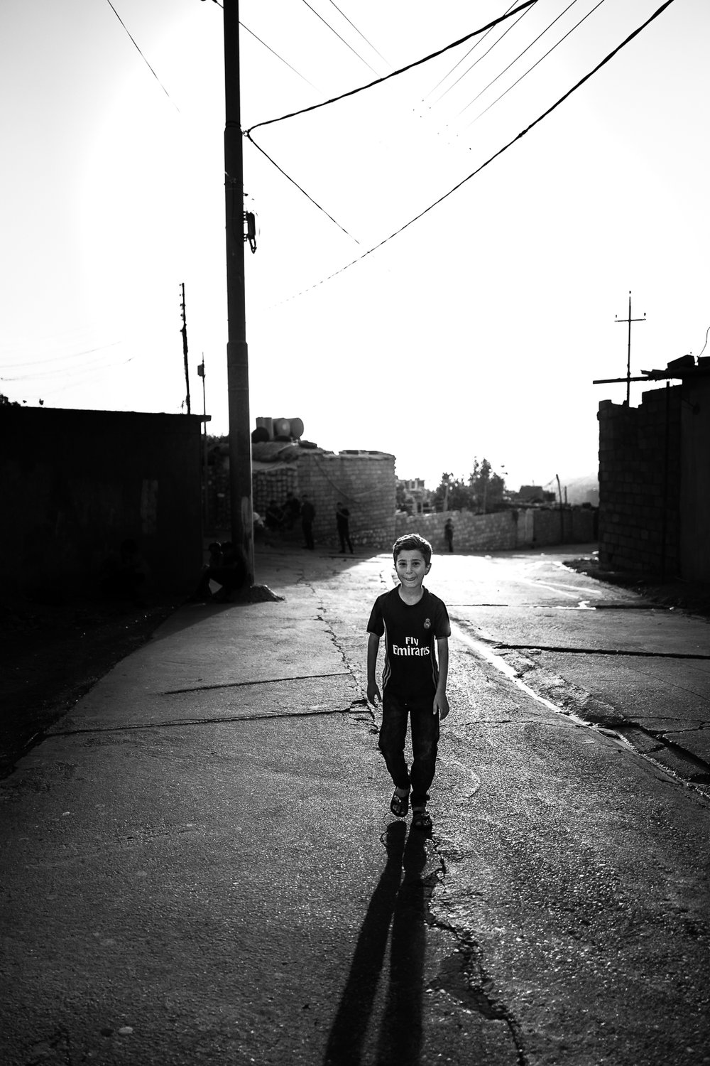 A child walks in front of me in the old city of Dohuk