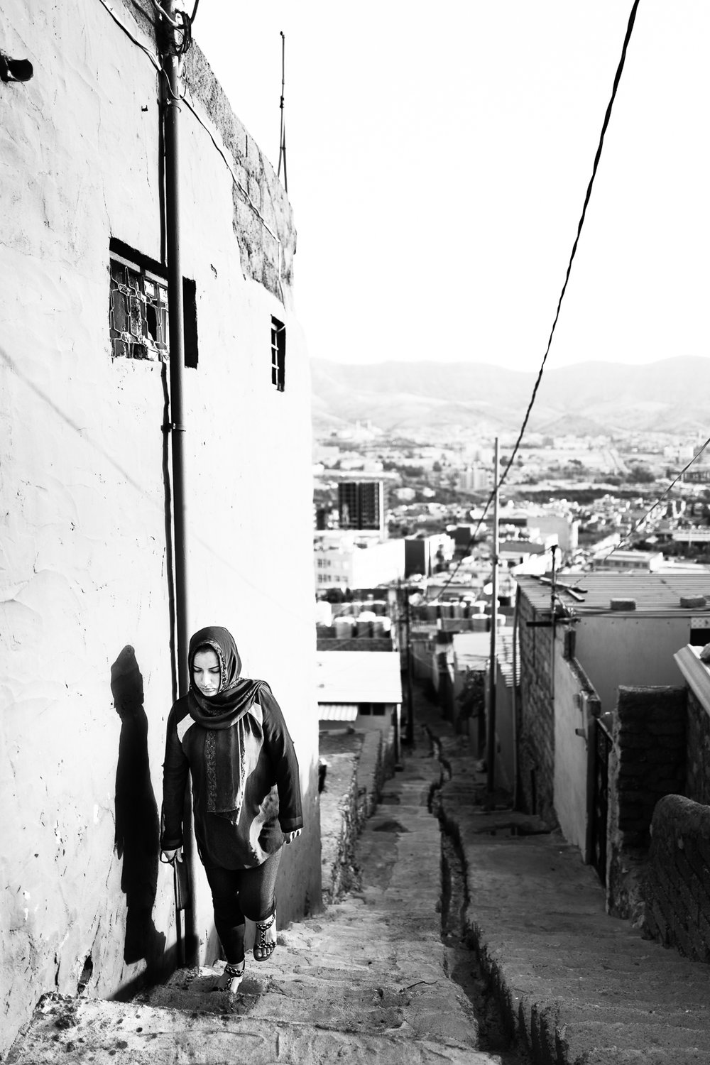 A young woman is reaching the old part of Dohuk city