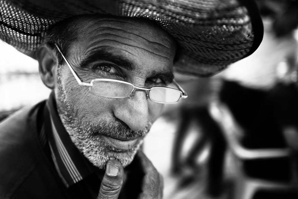 A seller and his hat in the central square of Erbil