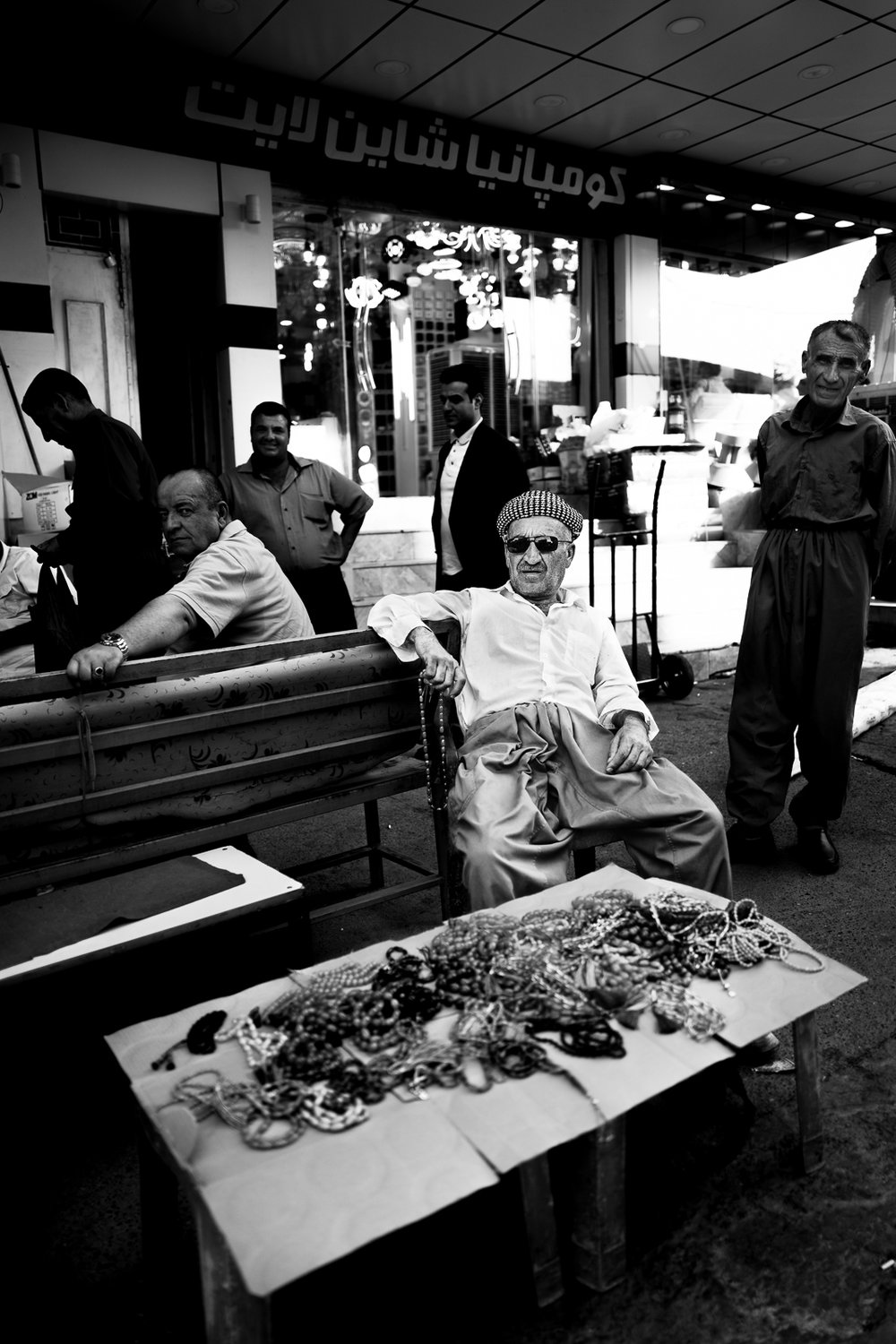 A man is selling rosaries on the streets of Douhk