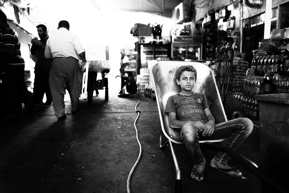 Child is taking is rest in his cart at the Erbil bazaar