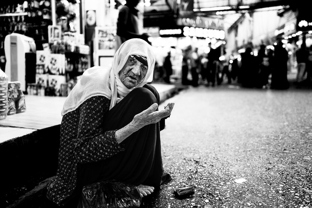 A beggar woman in the Douhk bazaar