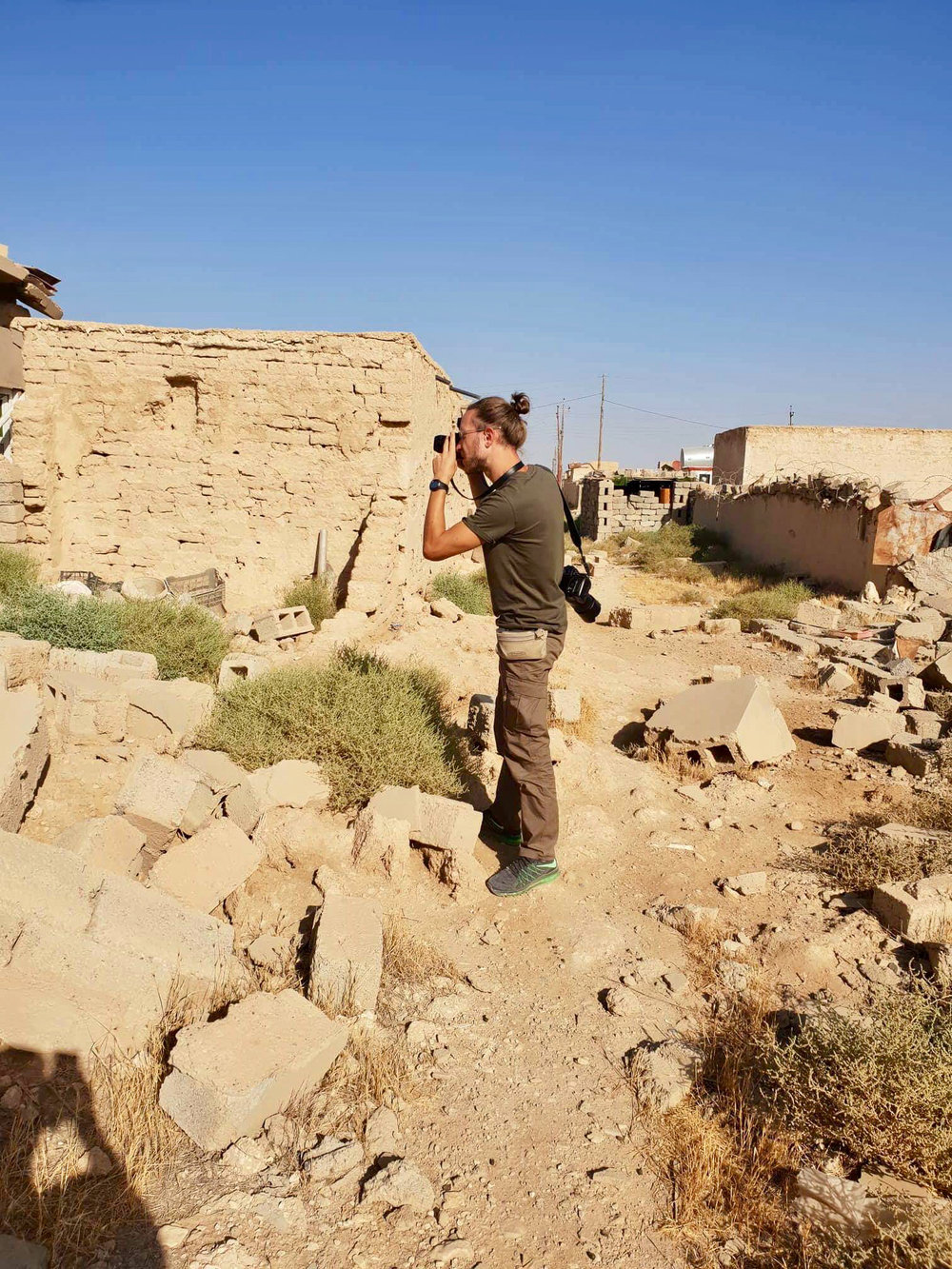 Me shooting in these empty and destroyed villages under the Sinjar mount