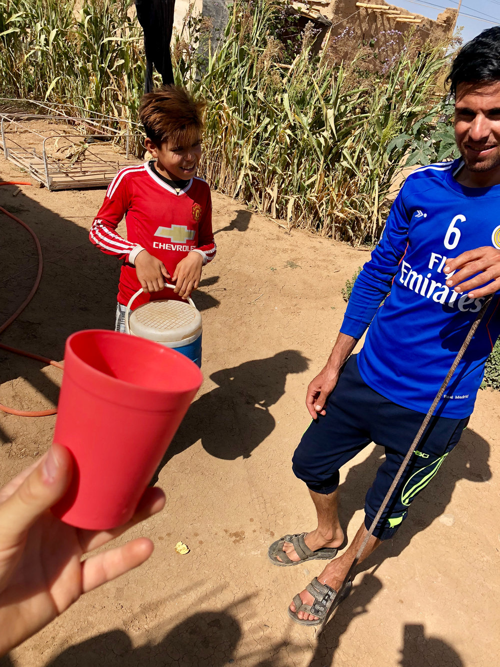 These young yazidi boys offered me a glass of water in an unofficial camp in the desert near Douhk