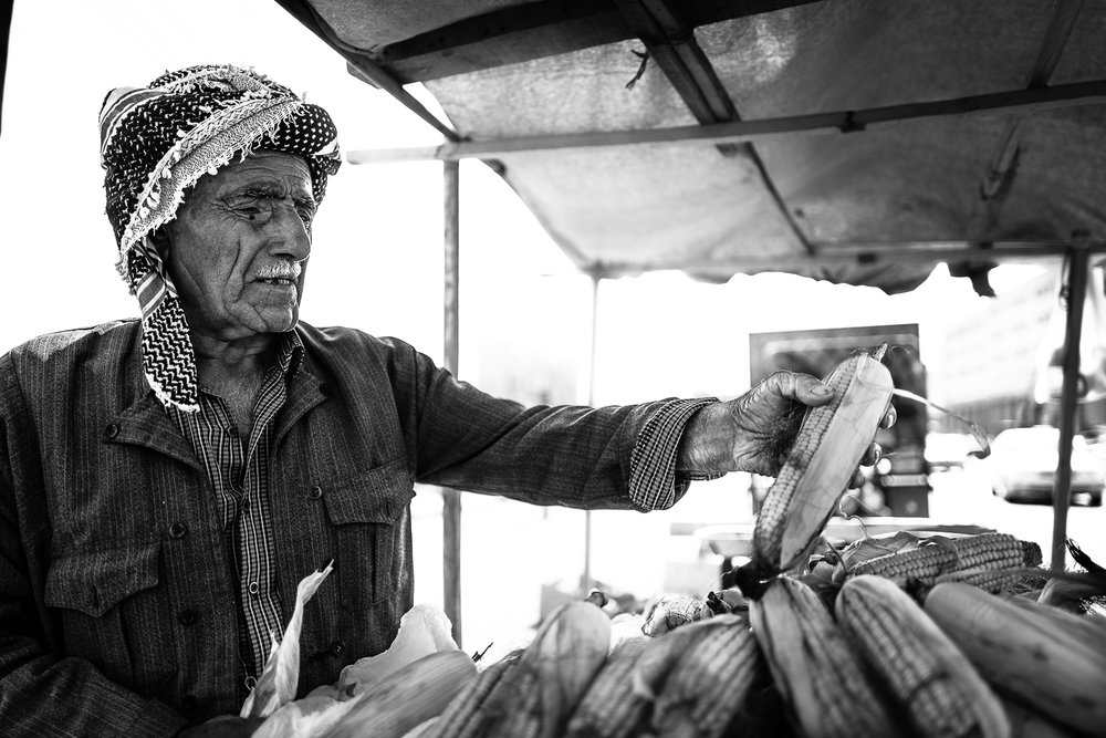 Corn seller in Erbil bazaar