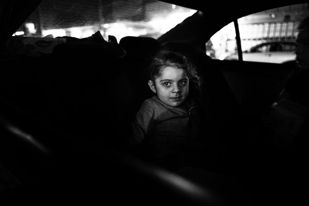 A little girl inside a car in Zakho
