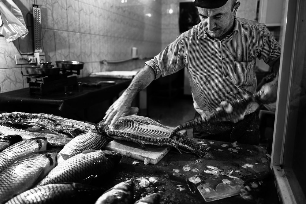 Fish seller in the Douhk meal bazaar