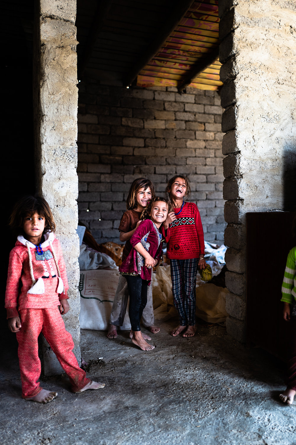 Little girl inside an under construction house in mount Sinjar
