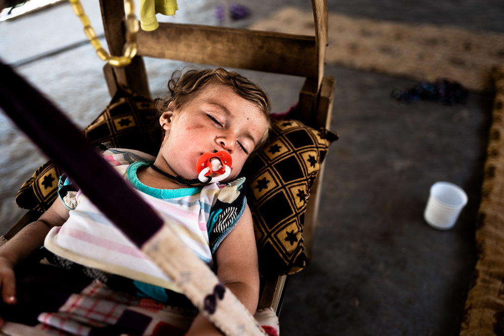 A child is sleeping in a tent in mount Sinjar