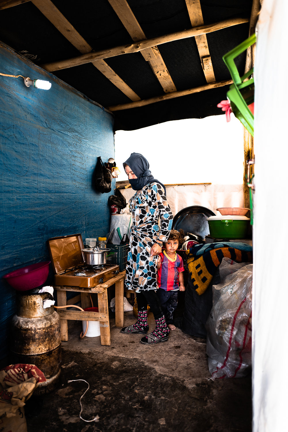 A mother and her son in a house in the Sinjar mount