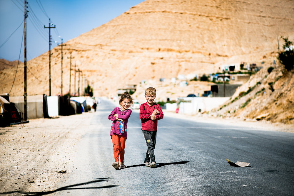 Happy children are playing with me on the road to Sinjar mount