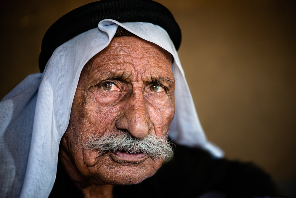 Old yazidi man inside his mud house. Unofficial camp in Sharya, near Dohuk