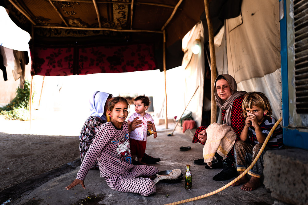 A family in the refugees camp of Khanik, near Douhk