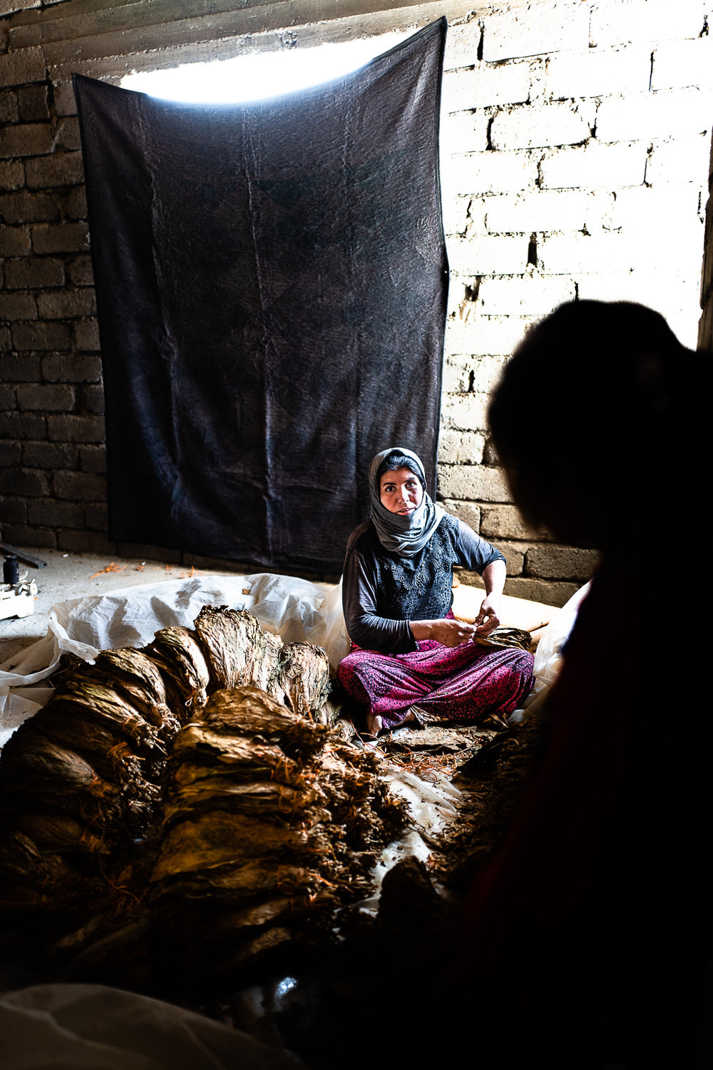A mother is working inside their house in mount Sinjar