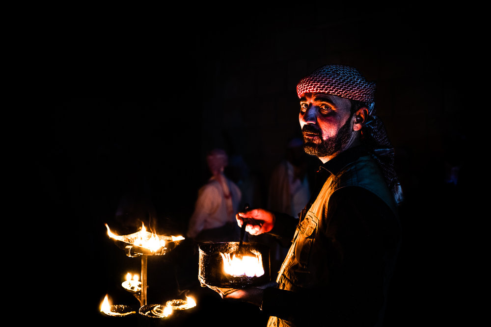 An important man who lightning the seven candles for the seven Yazidi angels during the rite