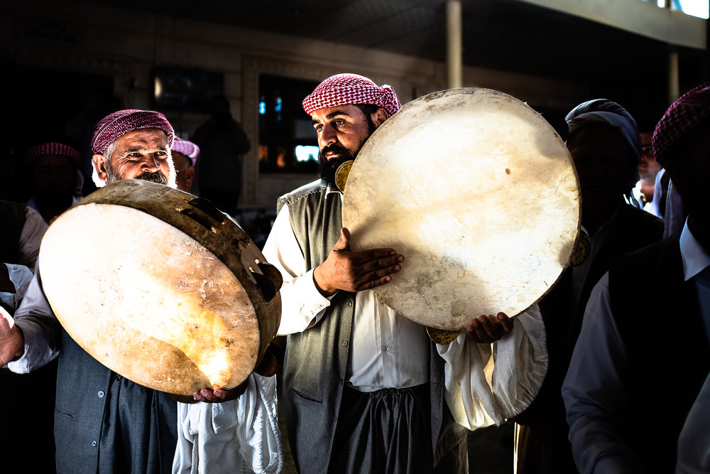 Traditional instrument players celebrate the beginning of Cejna Cemaiya festival at Baba Sheikh's house