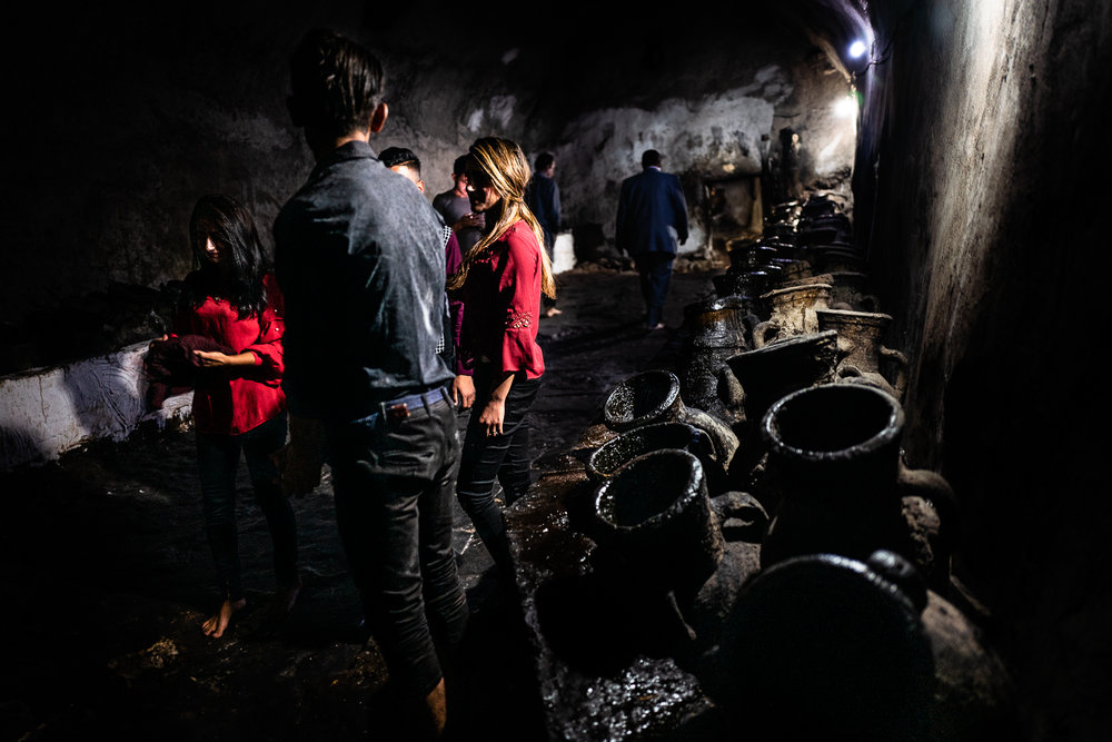 People inside the Lalish temple with the oil amphorae used for the holy candles