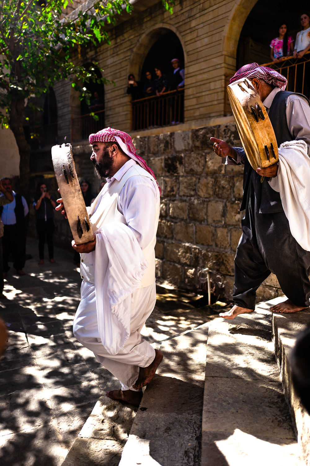 Religious singer men are entering in the temple of Lalish