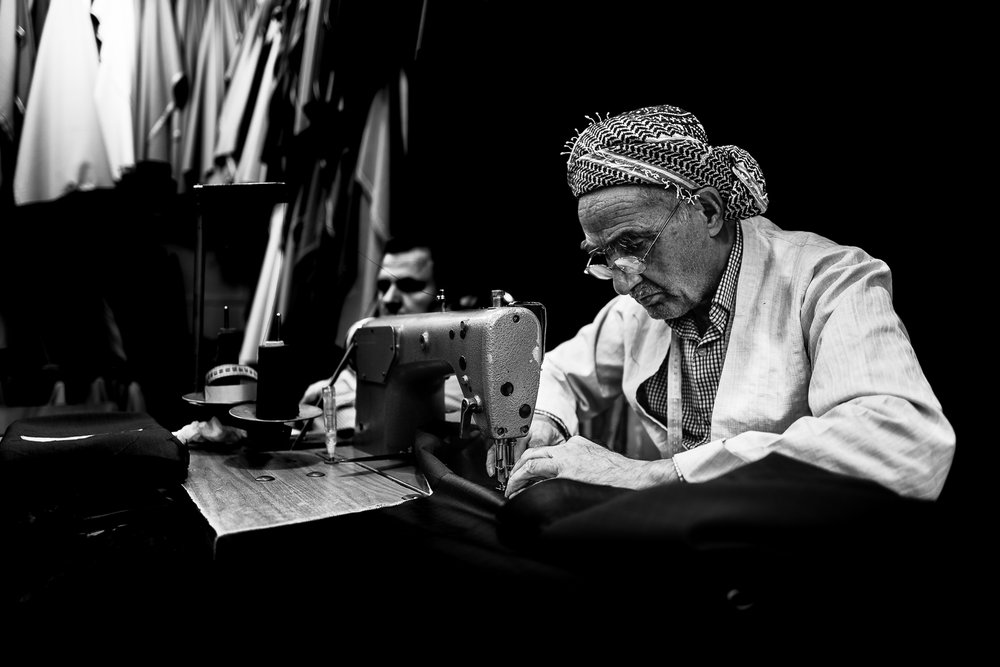 A tailor inside the Erbil bazaar