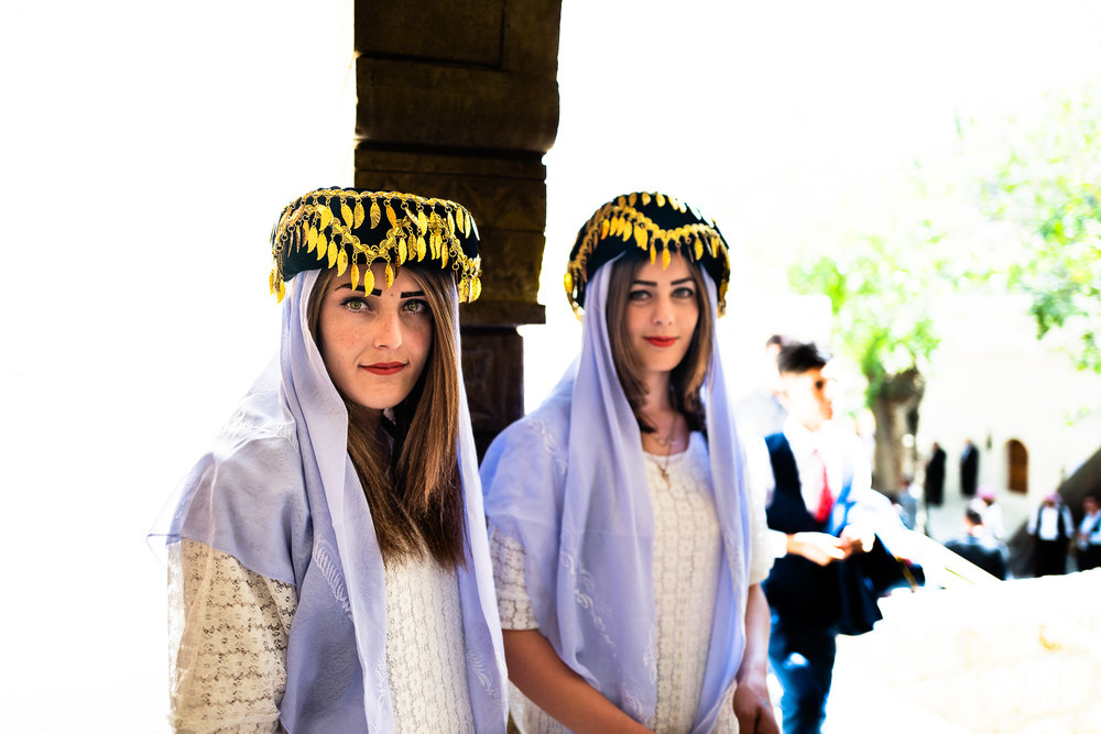 Two girls dressed with typical Yazidi clothes in Lalish