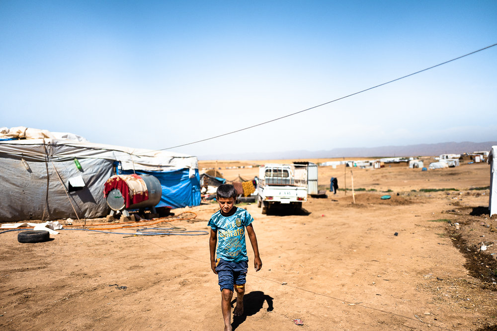 Boy who's living in a unofficial camp in Sharya, near Dohuk