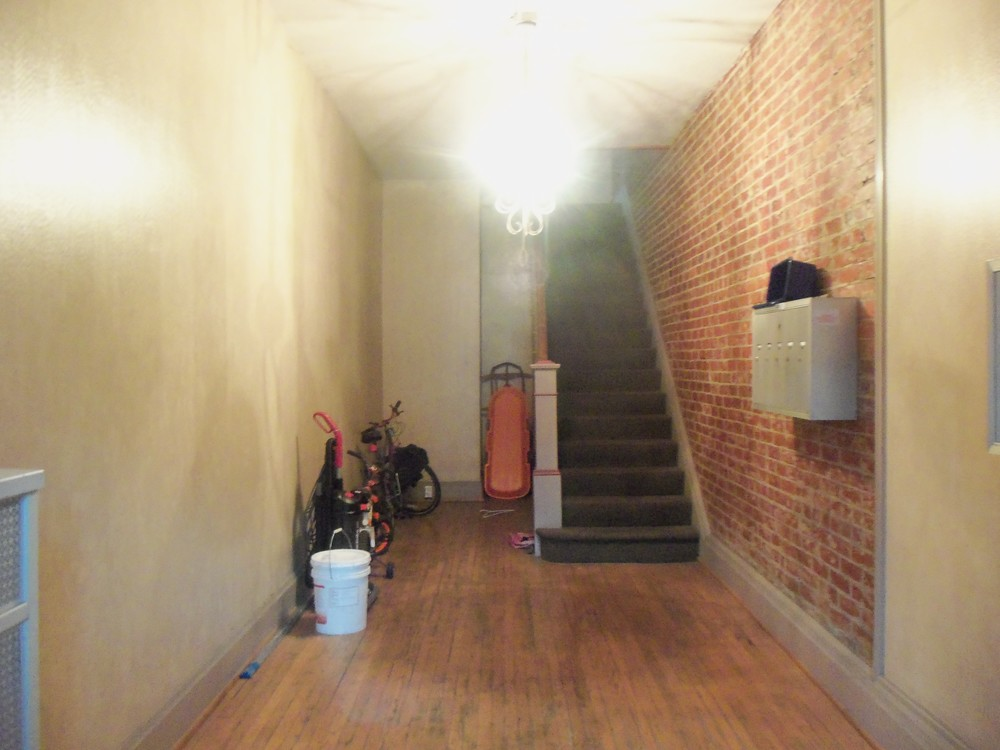 APARTMENT HALLWAY ON FIRST FLOOR     PHOTO BY KATHY STORRIE  7-26-14