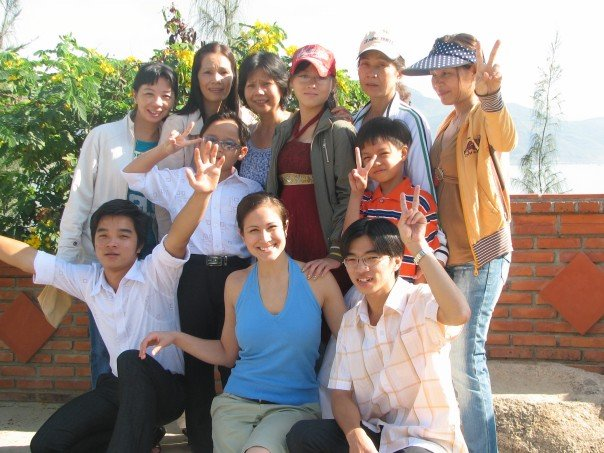 Pictured Above: Kim with cousins and aunts in Vietnam.