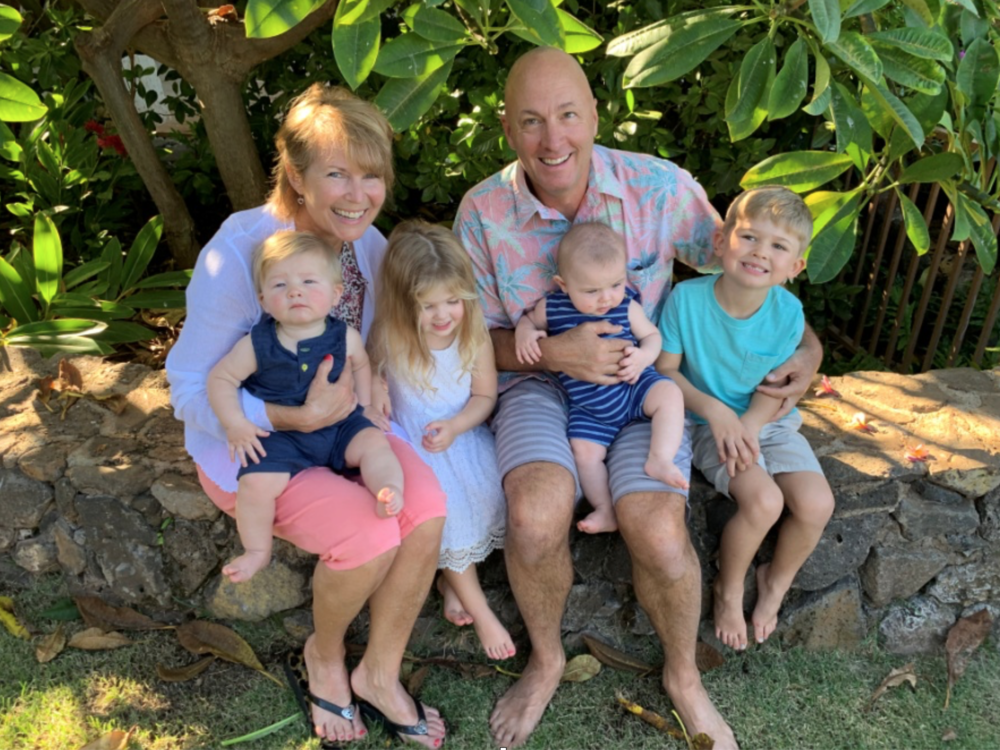 Cheryl and husband, Tom, with grandchildren Lewis, Isla, Boaz, and Eisley.