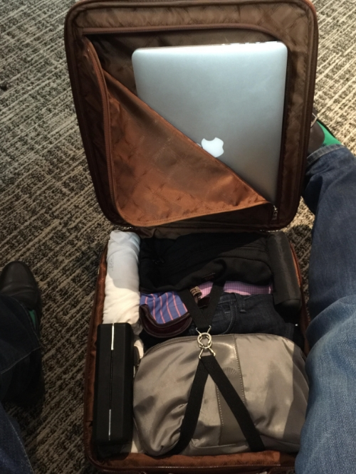 Packed as shown (including worn shoes, jeans, and blazer) for 4 days, 5 nights including 3 major client meetings