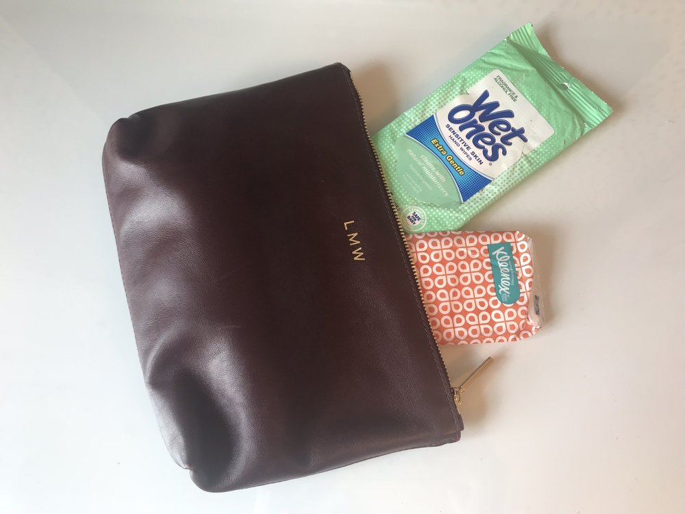 I carry this  Cuyana  pouch with me every single day.
