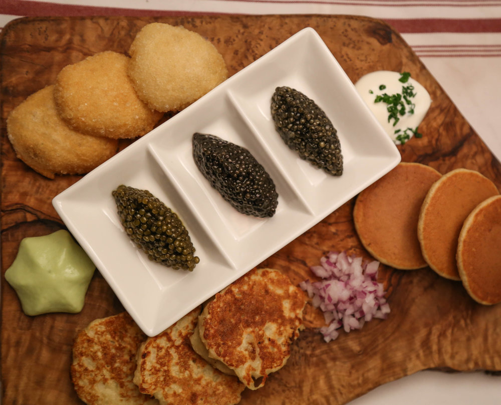 A generous tasting of Golden Russian Osetra, Siberian Sturgeon and Queen's Reserve White Sturgeon, all from the  California Caviar Company . Served with Einkorn and Banana Bellinis, Latkes, Pizza Fritta, Avocado and Sour Cream. Paired with   Billecart-Salmon Blanc de Blanc Brut en Magnum .