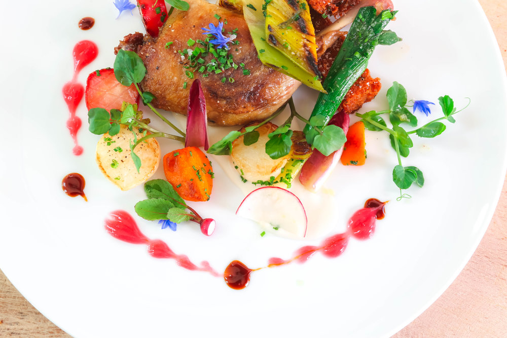 The Barn's CRISPY DUCK CONFIT, on the dinner menu, with white bean purèe, tokyo turnips, baby carrots, pomme paillasson.