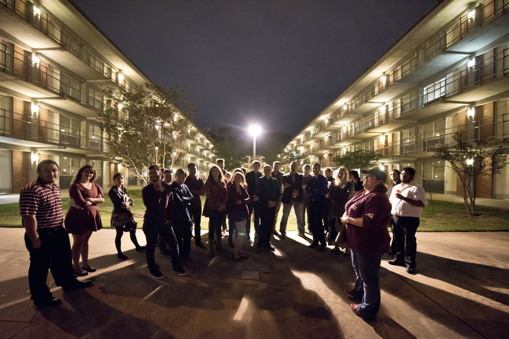 Former Texas A&M Students Erica Alcala, right, talks to current students living in her old dormitory, the FHK dorms, about her experience in the dorms and building the bonfire, early Friday morning, Nov. 18, 2016, in College Station, Texas. Three of the 12 students that perished when the bonfire collapsed lived in the FHK dorms with Alcala.