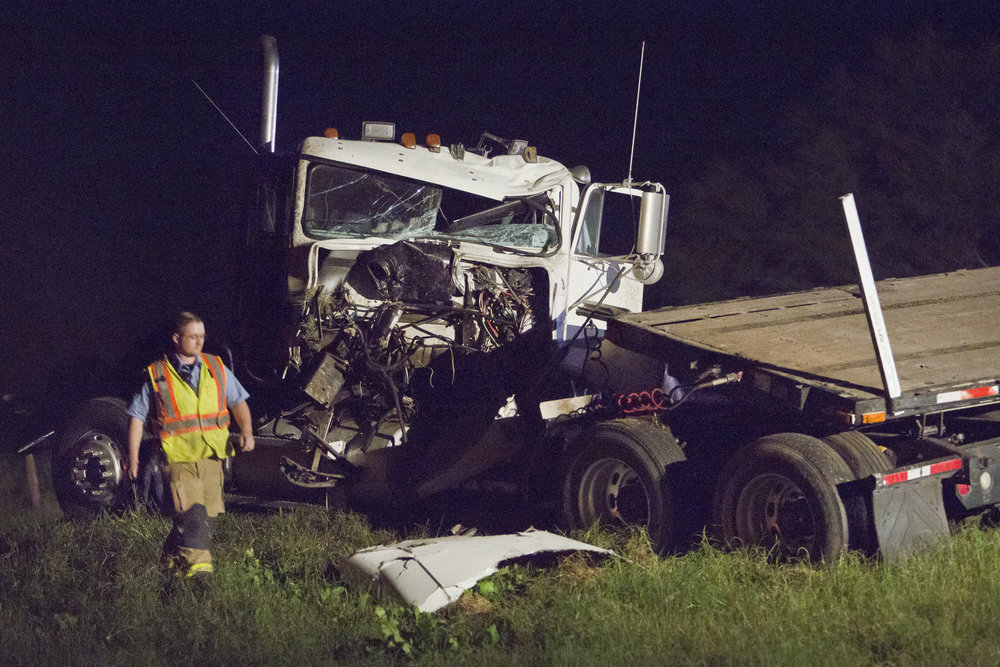 First responders look over the scene of a wreck between two semitrailers Wednesday evening, Nov. 16, 2016, on Highway 21, just East of Fickey Road outside of Kurten, Texas. The wreck shut down the eastbound lane of 21 for multiple hours overnight.