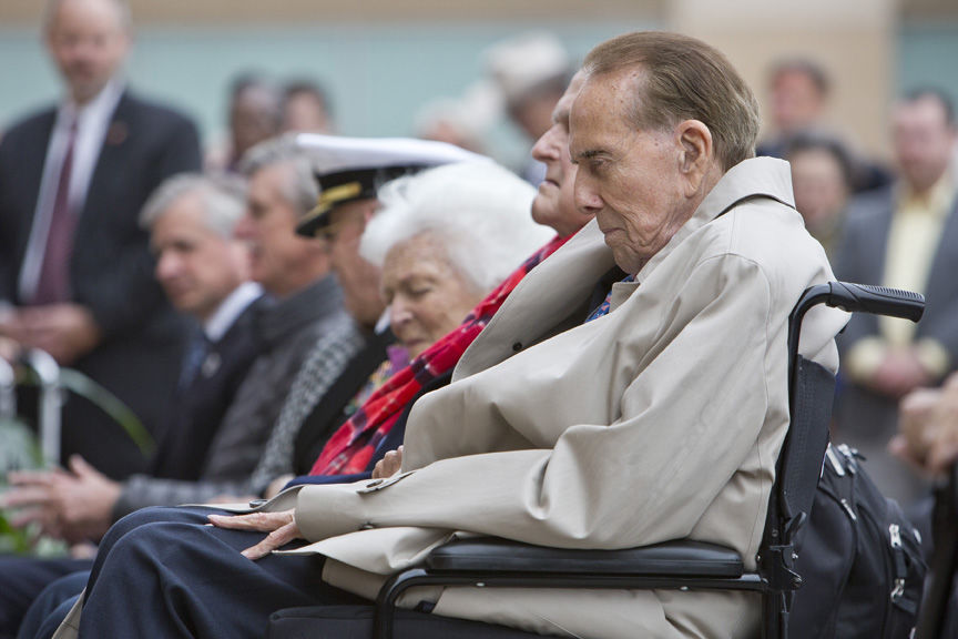 Former Sen. Bob Dole sits next to former President George H.W. Bush and former first lady Barbara Bush at the George H.W. Bush Presidential Foundation 75th Anniversary of the Pearl Harbor Attack on Wednesday in College Station.